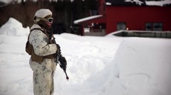 Stock Video Footage of Norway, March 2016, Nato Soldier Stand Snow Area Building Background