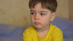 Small boy 3 years looking into the camera depicting various emotions Stock Footage