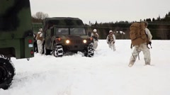 Norway, March 2016, Nato Soldier Walk Snow Vehicles - stock footage