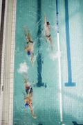 Three swimmer swimming in the pool at leisure center Stock Photos