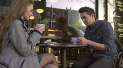 Man and Woman on date in front of shop Stock Footage