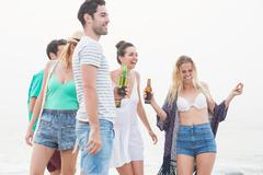 Group of friends having a party on the beach Stock Photos