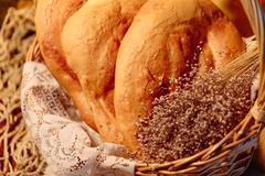 Several Armenian homemade mantakash bread in a basket - stock photo