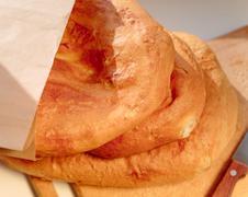 Several armenian homemade bread mantakash in a paper bag - stock photo