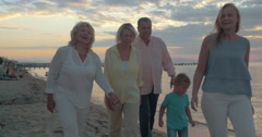 Big Family Sitting at the Table on the Beach Stock Footage