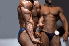 Bodybuilder's side tricep pose. - stock photo