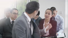 4K Business man & woman in discussion during business conference - stock footage