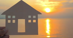 Owning a seaside house - stock footage