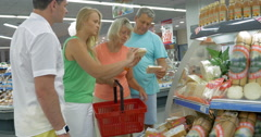 Big Family Choosing Wedges of Cheese in the Supermarket Stock Footage