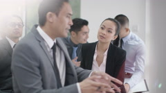 4K Cheerful Asian business group listening to business presentation Stock Footage