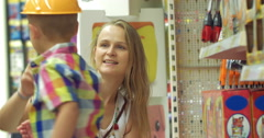 Mother and son in toy shop Stock Footage
