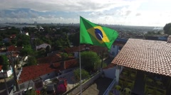 Brazilian Wave Flag on a Top of House in Olinda, Pernambuco, Brazil Stock Footage