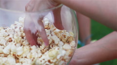 Capacity with popcorn. Sweet popcorn in the aquarium. - stock footage