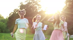 Girls dancing in the park. The bright glare of the sun. Cute girl walking in the Stock Footage
