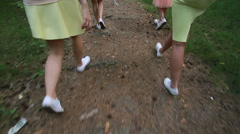 Girl walking on a forest path. Slender legs. White sneakers. Forest Trail. Walk - stock footage