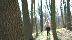 The girl who ran was on a break near a tree. 4k Stock Footage