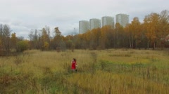 National park on Elk Island with woman which runs among grass Stock Footage