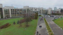 People walk near entrance of MGIMO at autumn cloudy day. Stock Footage
