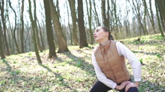 Beautiful girl doing exercises in the woods. 4k Stock Footage