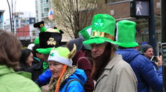 People in green hats Vancouver street - stock footage