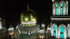 Cupola and tower on roof of Cathedral Mosque with illumination Stock Footage
