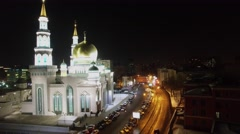 Edifice of Cathedral Mosque on street with cars at autumn evening. - stock footage