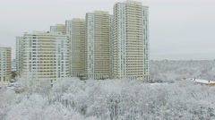 Residential complex among snow-bound trees on Elk Island - stock footage