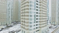Residential complex with snow-covered yard at winter day. Aerial view Stock Footage