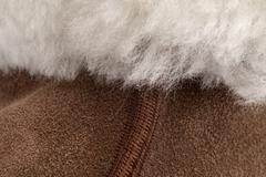 White Fur Over Brown Shearling and Seam - stock photo