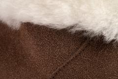 White Sheepskin Over Brown Shearling and Stitching Stock Photos