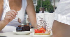 People eating desserts and drinking coffee in cafe Stock Footage