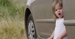 Slow Motion Cute Little Girl in Van Turns Looking Surprised Stock Footage