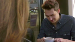 Handsome guy takes sip of coffee Stock Footage