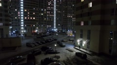 Car parking near tall houses of dwelling complex at winter Stock Footage