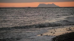 Gibraltar rock at sunset, UK, view from Spain, Estepona Stock Footage