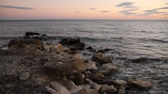 Coast wave and rocks at sunset, Spain, Estepona, Costa del Sol, Andalucia Stock Footage