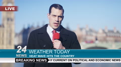 4K Weather reporter doing live piece to camera outdoors in the city of London Stock Footage