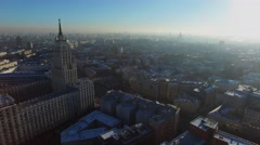 Cityscape lit bu sunlight at winter sunny day. Aerial view Stock Footage