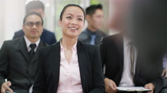 4K Cheerful Asian business group clapping the speaker at business conference - stock footage