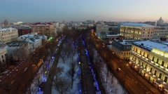 City traffic on Chistoprudniy boulevard with garlands on trees Stock Footage