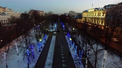 Chistoprudniy boulevard with garlands on trees and car traffic Stock Footage
