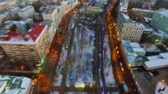 Street traffic on Chistoprudniy boulevard with garlands on trees Stock Footage