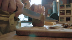 A chef cutting peel of kiwi on cutting board, 4k - stock footage