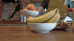 A chef putting the plates with vegetables and fruits on the table, 4k Stock Footage