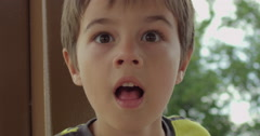 Slow Motion Boy Stares in Shock or Awe - stock footage