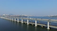 Car traffic on Banpodaegyo bridge and megapolis on shore of river Stock Footage