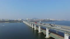 Banpodaegyo bridge with transport traffic against cityscape at autumn Stock Footage