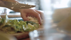 A chef chops the chees on cutting board, slow motion Stock Footage