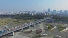 Cityscape with transport traffic on flyover of Olympic freeway Stock Footage