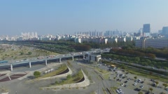 Cityscape with transport traffic on interchange of Olympic freeway Stock Footage